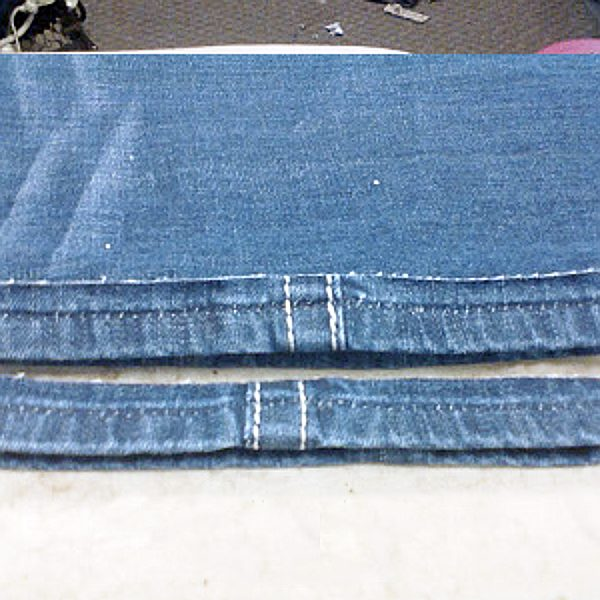 Hemming jeans cut and trimmed ready to reattach