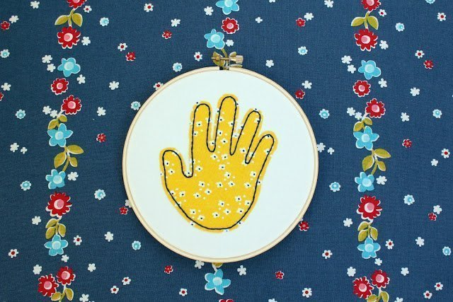 Embroidered handprint from fabric scraps