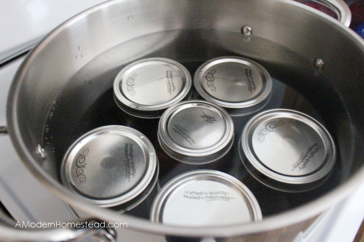 Canning cranberry sauce in water bath canner.