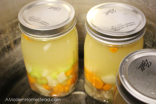 chicken soup in mason jars ready for canning