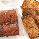 homemade banana bread sliced on parchment paper