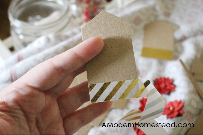 Add tape to the bottom of diy christmas gift tags