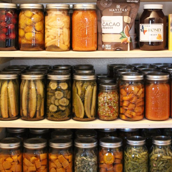 canned pickles on the pantry shelf