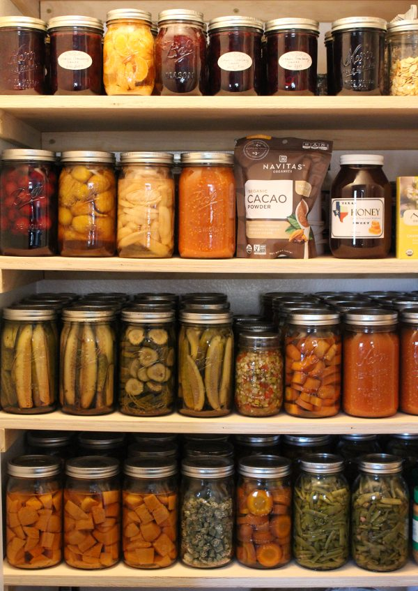 Pantry full of home canned food in canning jars