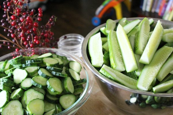 Cucumbers sliced and ready for canning pickles