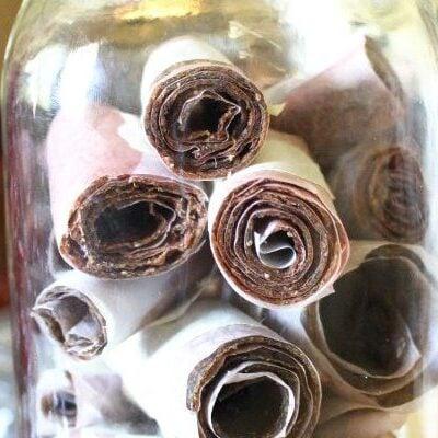homemade strawberry zucchini fruit leather rolls in mason jar