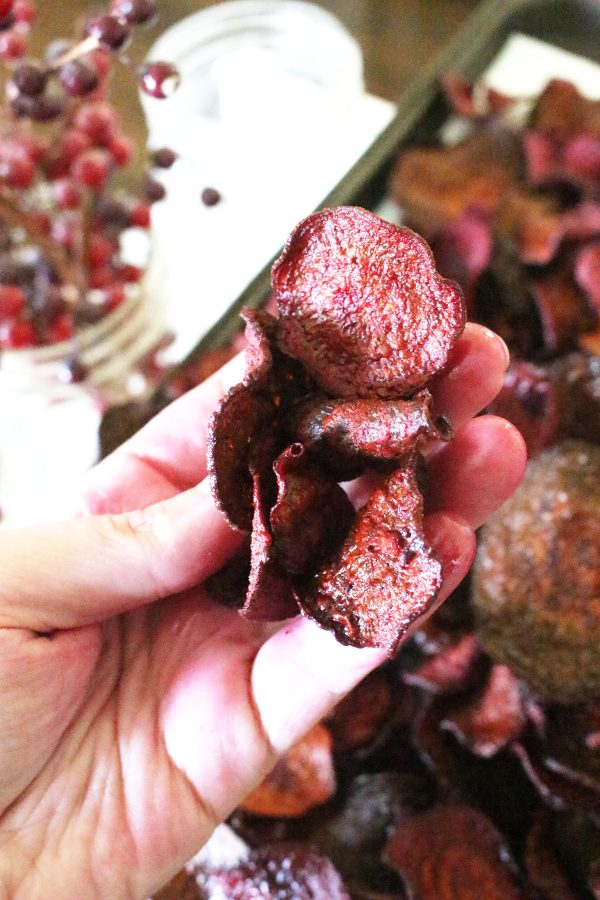 Homemade beet chips in hand