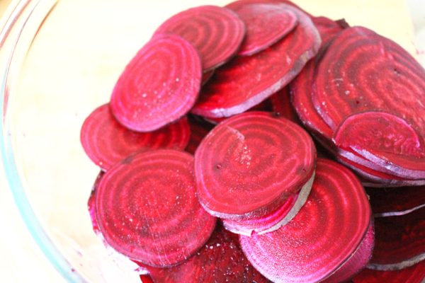Sliced beets in a clear bowl