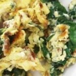 This cheesy bacon and spinach scrambled eggs recipe is easy to make and delicious. Plus it's naturally low carb (and tastes great on a tortilla too)!