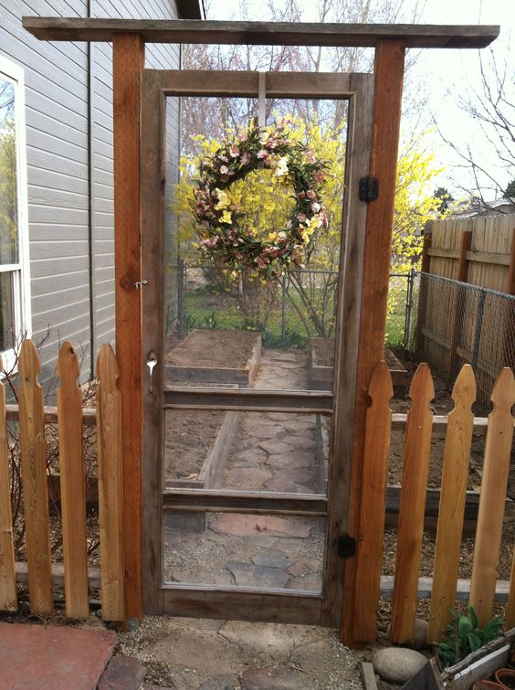 Turn An Old Screen Door Into A Garden Gate! Notice The Bent Spoon Handle,  Another Great Repurposed Item! Source: G Is For Garden