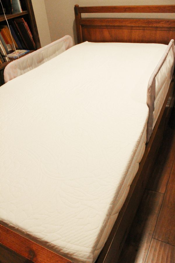 full length image of best organic mattress in a bed frame no sheets - Best Organic Mattress