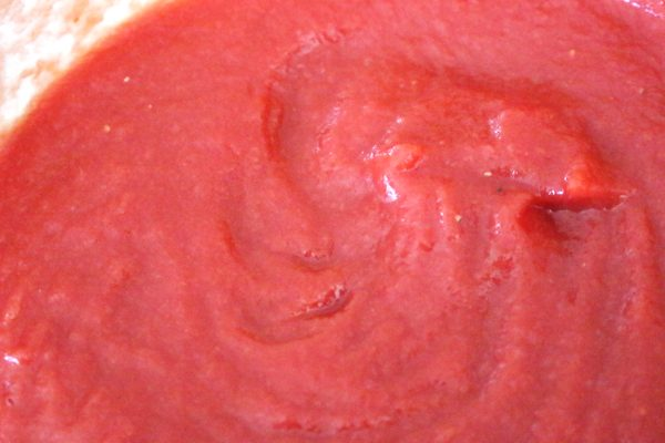homemade ketchup in pan, close up of texture