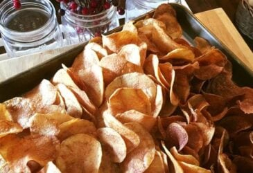 homemade potato chips on baking sheet