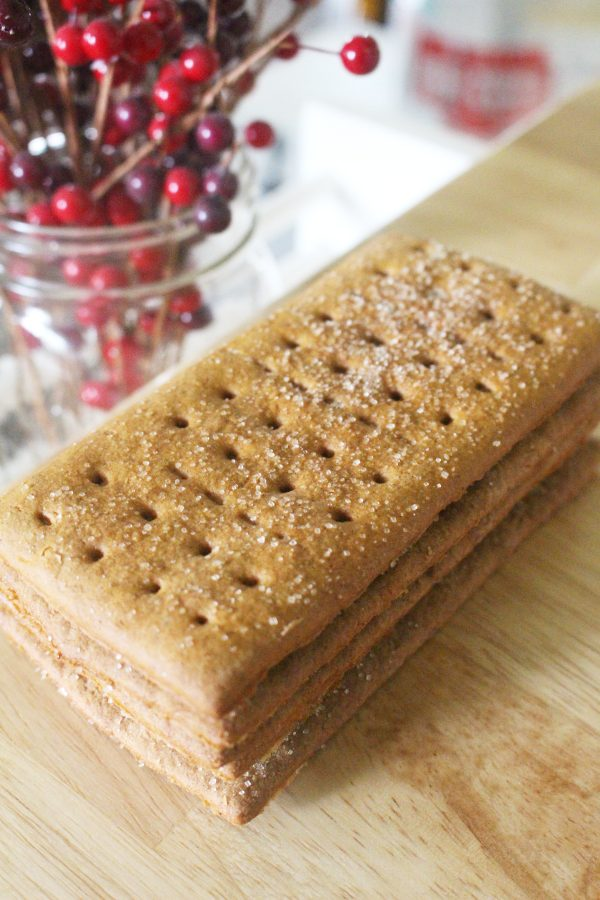 homemade graham cracker recipe in a stacked pile on counter top