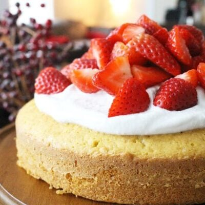 Strawberry shortcake on wooden cake stand