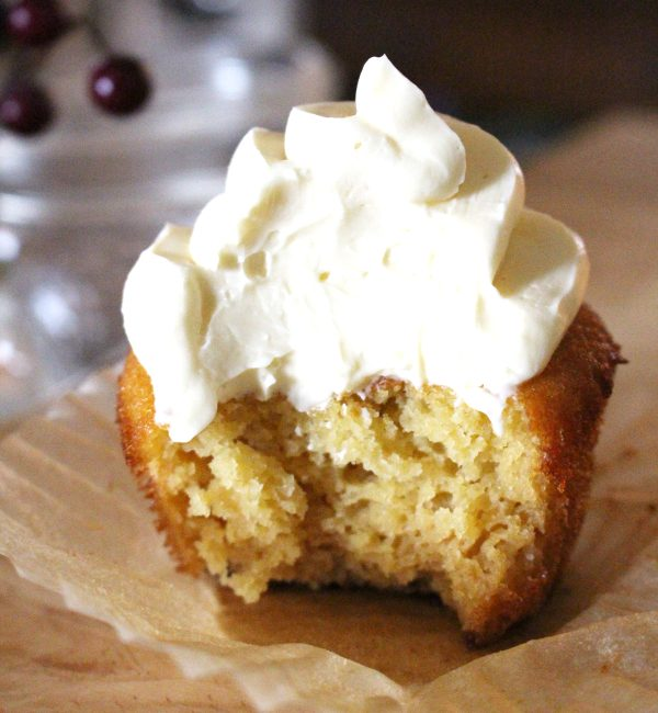 Honey Vanilla Buttercream Frosting on Cupcake with a bite out of it.