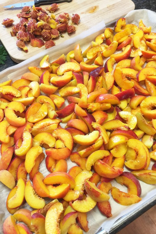 Fresh peaches sliced and pitted before freezing