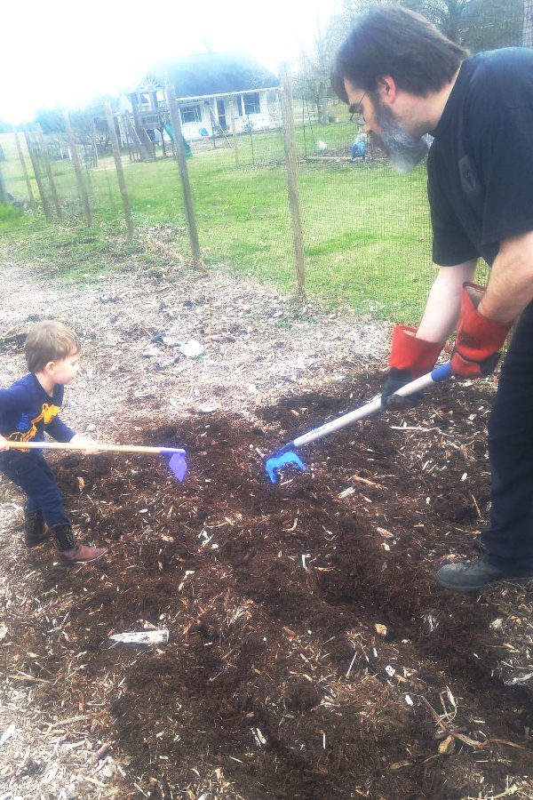 father and son working in the garden together