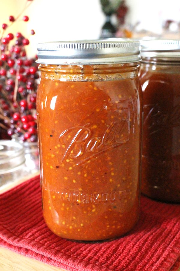 Homemade canned tomato sauce in a canning jar