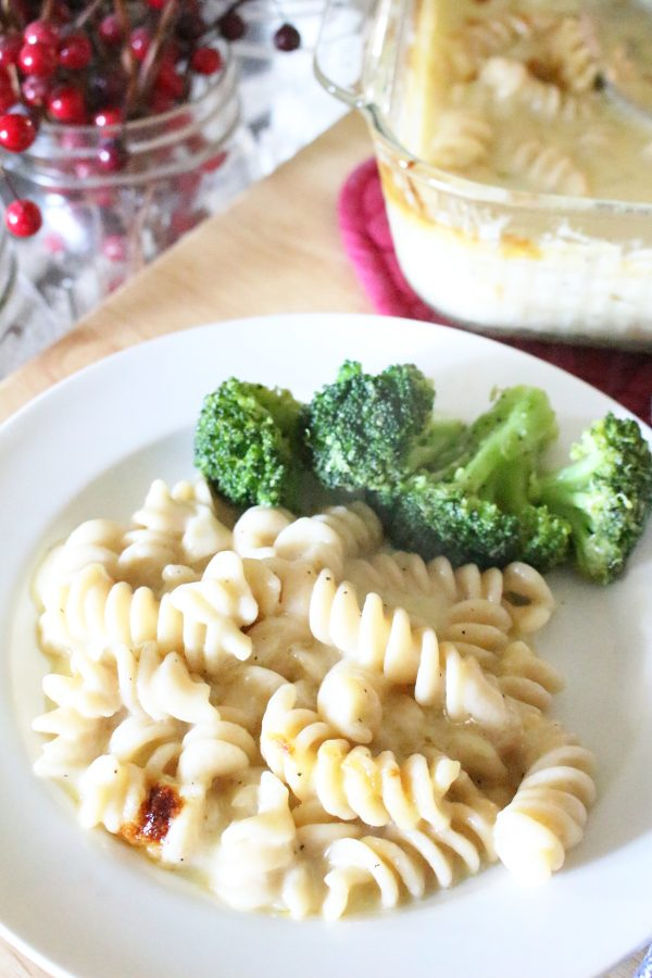 Baked macaroni and cheese on a plate with broccoli