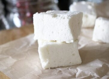 healthy easy homemade paleo marshmallows in a pile on parchment paper
