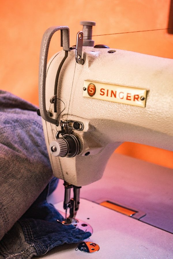 sewing machine sitting with fabric under the needle