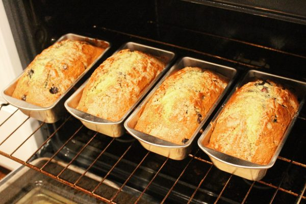 4 loaves of homemade blueberry bread in the oven