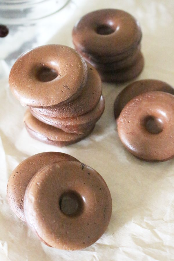mini keto donuts with chocolate and almond butter stacked in piles