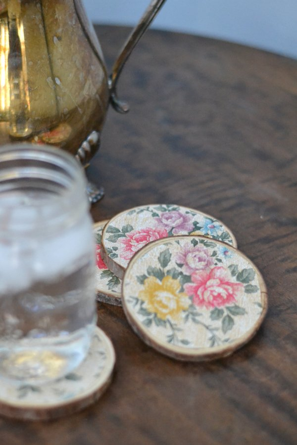 vintage floral wood coasters sitting on a table with drink