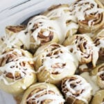 einkorn cinnamon rolls with cream cheese icing in pan