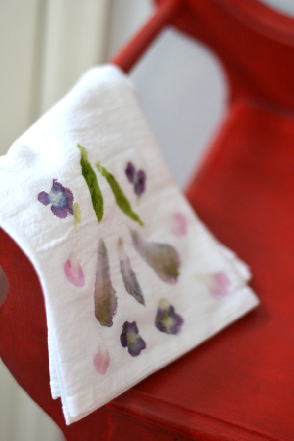 tea towel with natural dye on red side table