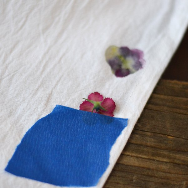 flowers taped to a tea towel