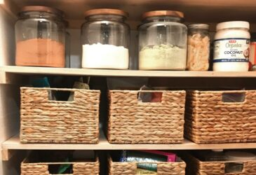 glass jars and baskets on pantry shelves
