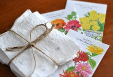 organic homemade seed paper with seed packets sitting on a table