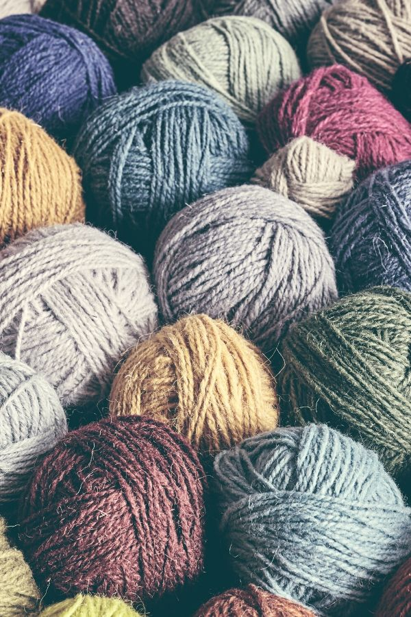 many different colors of yarn balls