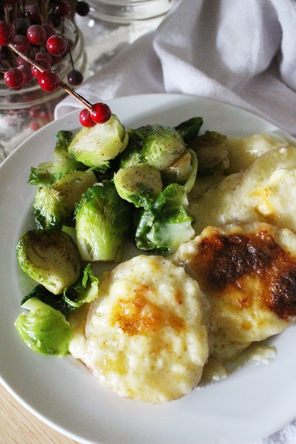 homemade potatoes au gratin with brussel sprouts