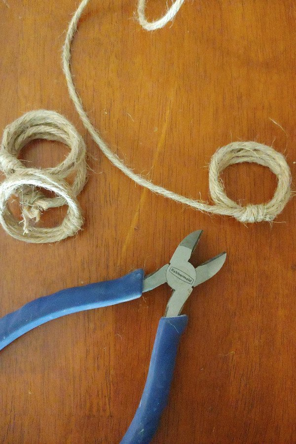 jute cord and wire cutters sitting on a table