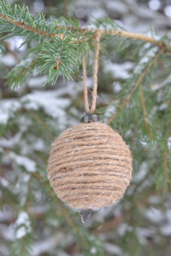 jute cord DIY Christmas ornament hanging in a pine tree