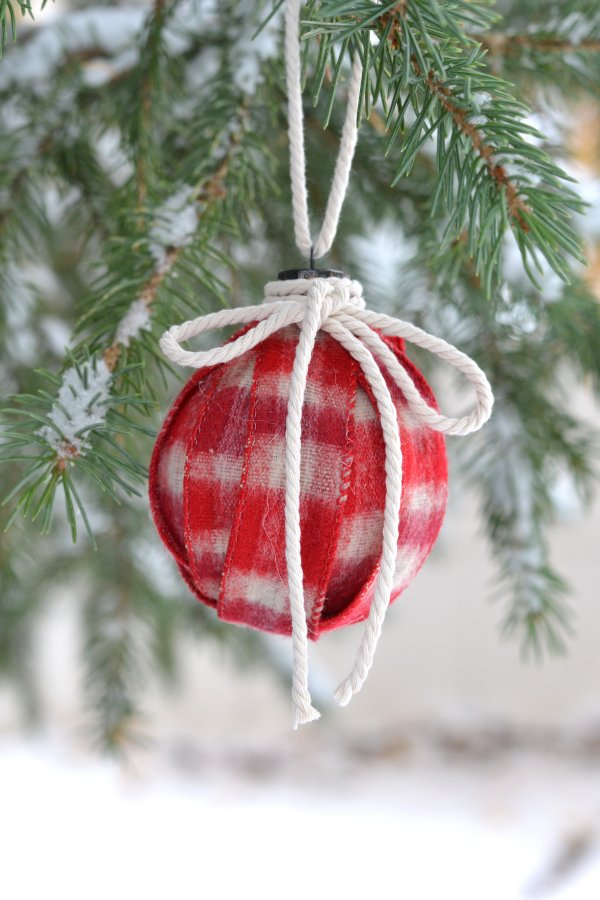 DIY ribbon ornament hanging in a pine tree