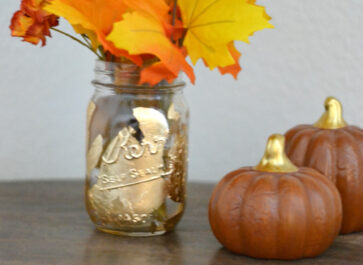fall gold leaf mason jar vase sitting on a table
