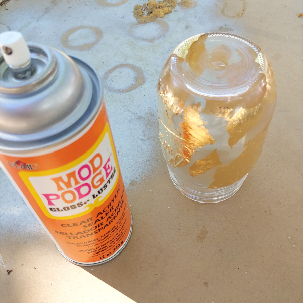 sealing a gold leaf mason jar with mod podge