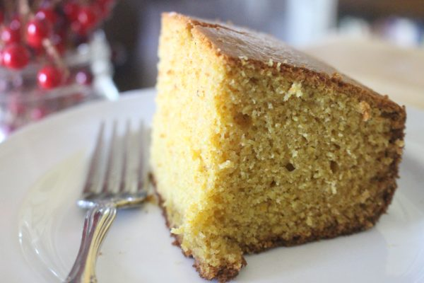 Thick slice of homemade cornbread on a white plate