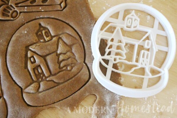 Christmas snow globe cookie cutter cookie stamp in gingerbread dough