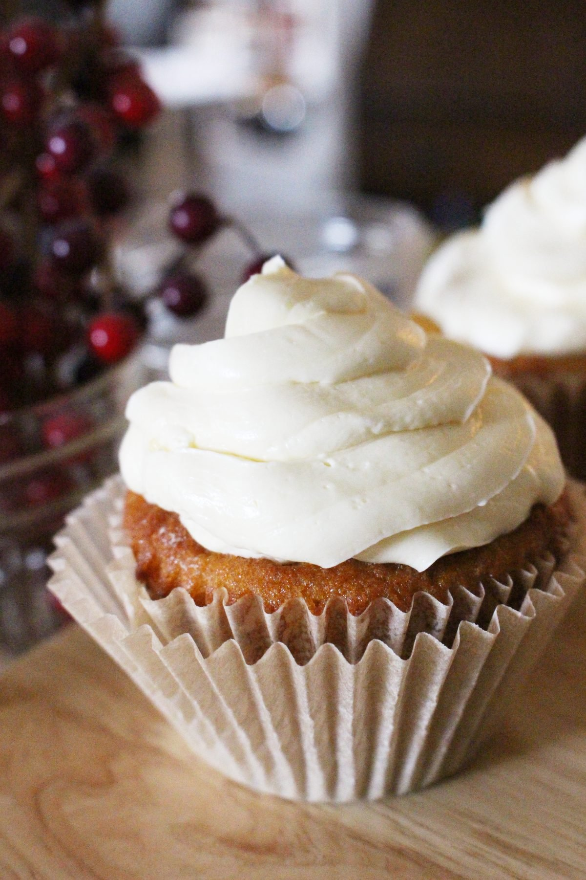 Paleo GAPS coconut flour vanilla cupcakes with buttercream icing in a cream cupcake wrapper