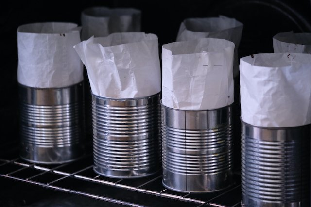 many coffee cans lined with parchment and filled with einkorn kulich