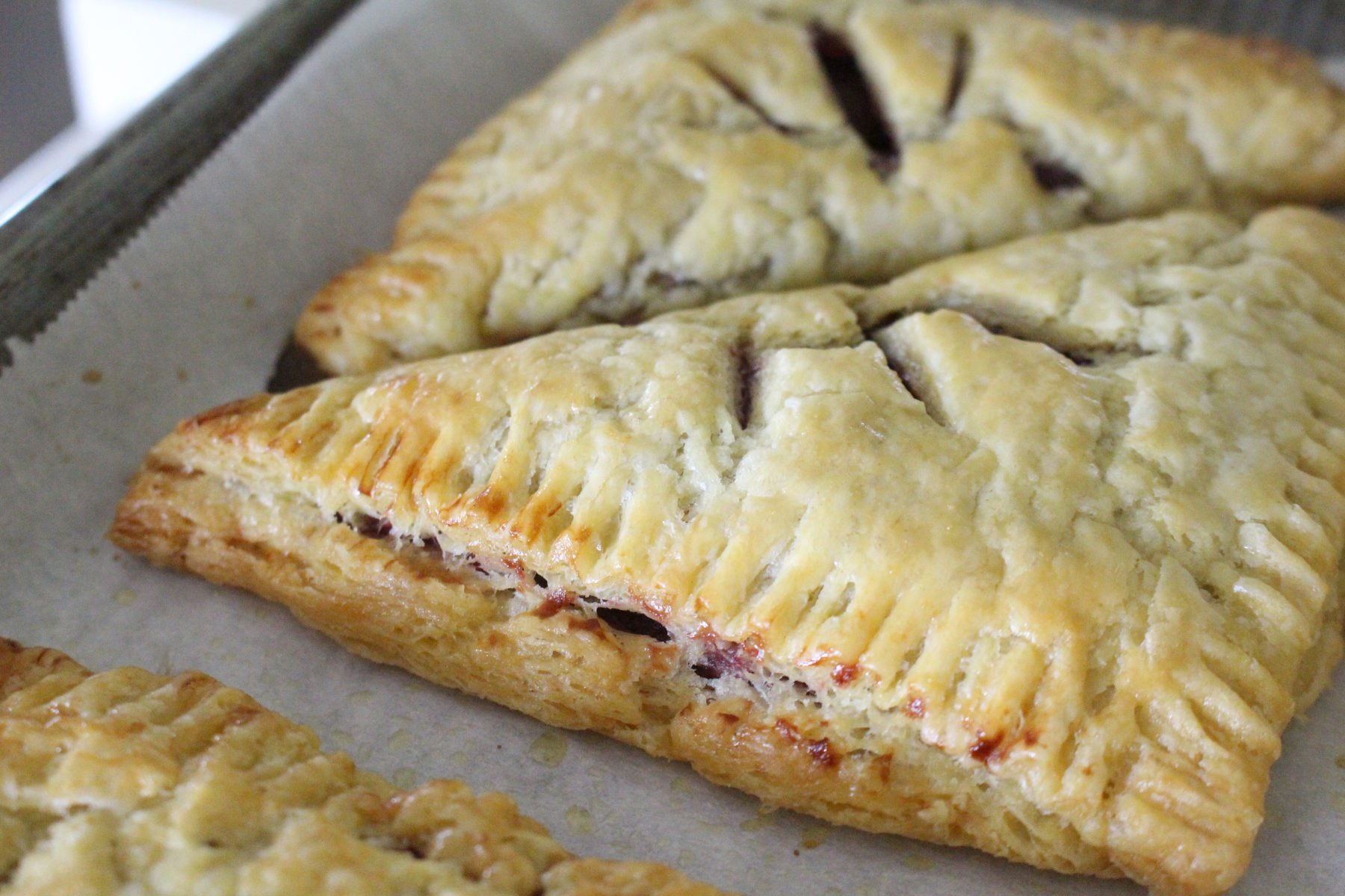 Homemade einkorn puff pastry turned into cherry turnovers