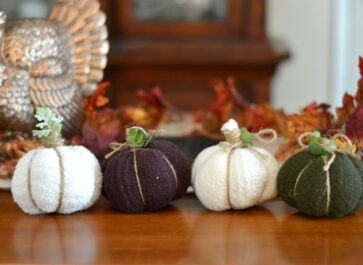 No-sew fabric sweater pumpkins sitting on a table