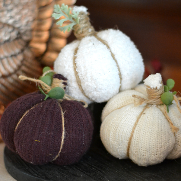 No-sew handmade fabric pumpkins sitting on a table